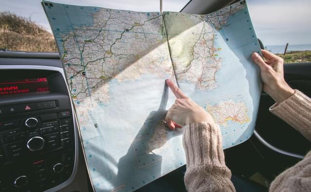 Looking into the map while on the road - Schill Insurance