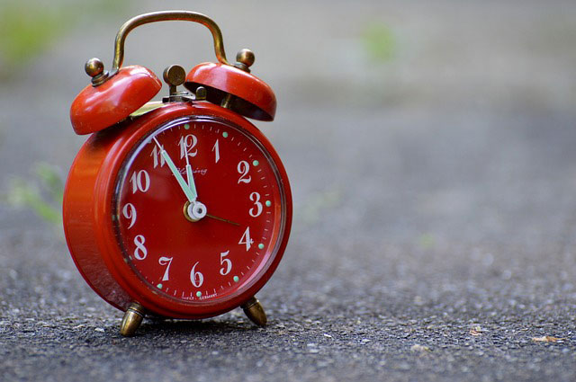 red clock on the street