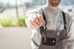 men giving away car keys